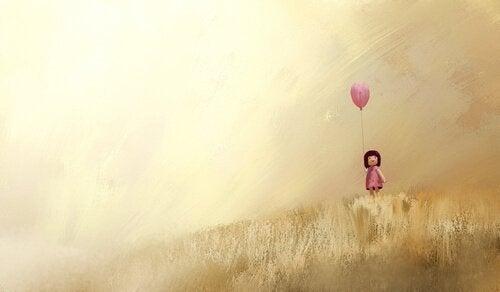 niña-con-globo-rosa