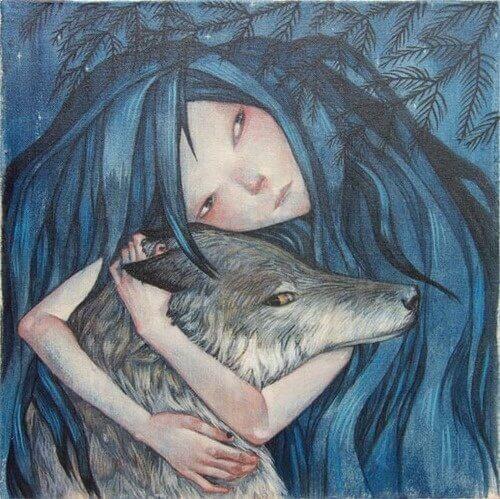 Mujer-abrazando-la-cabeza-de-un-lobo