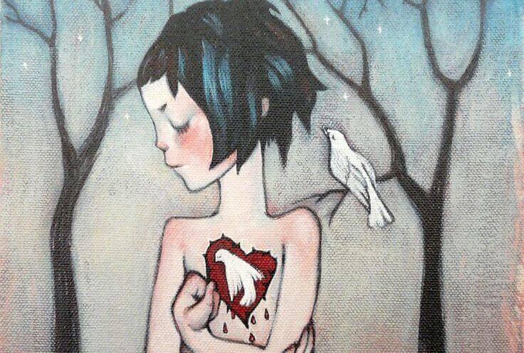 petite-fille-avec-un-coeur-en forme-de-colombe