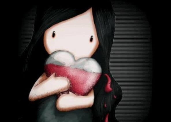 Niña-sosteniedo-corazón-entre-sus-brazos