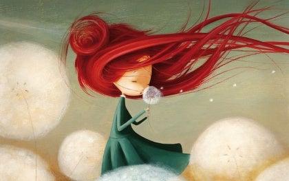 femme avec les cheveux rouges qui volent