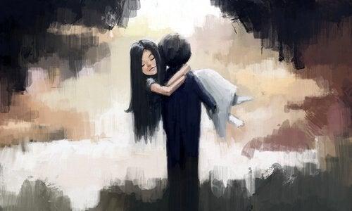 Garcon-prend-une-fille-dans-ses-bras1