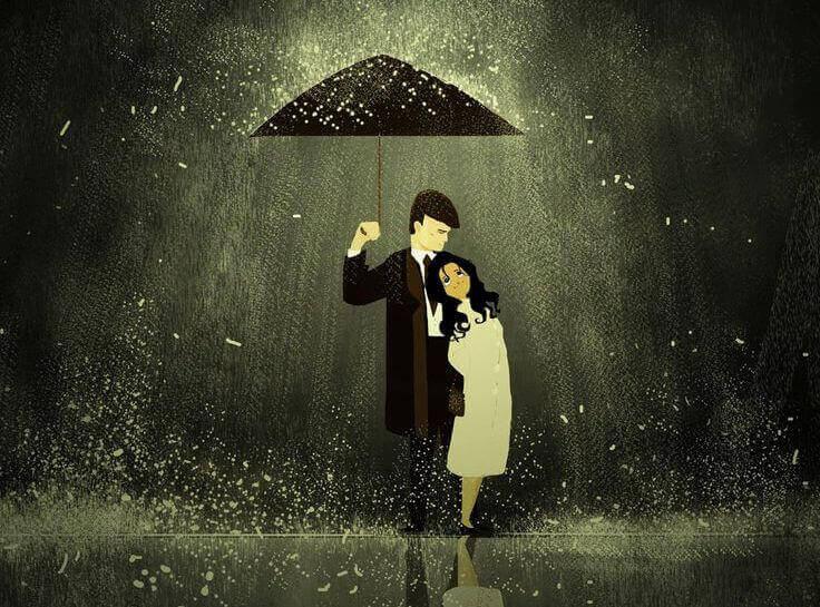 Hombre-y-mujer-debajo-de-un-paraguas-lloviendo