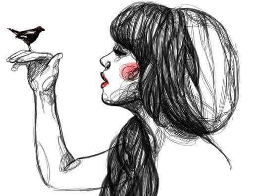jeune fille avec un oiseau dans la main