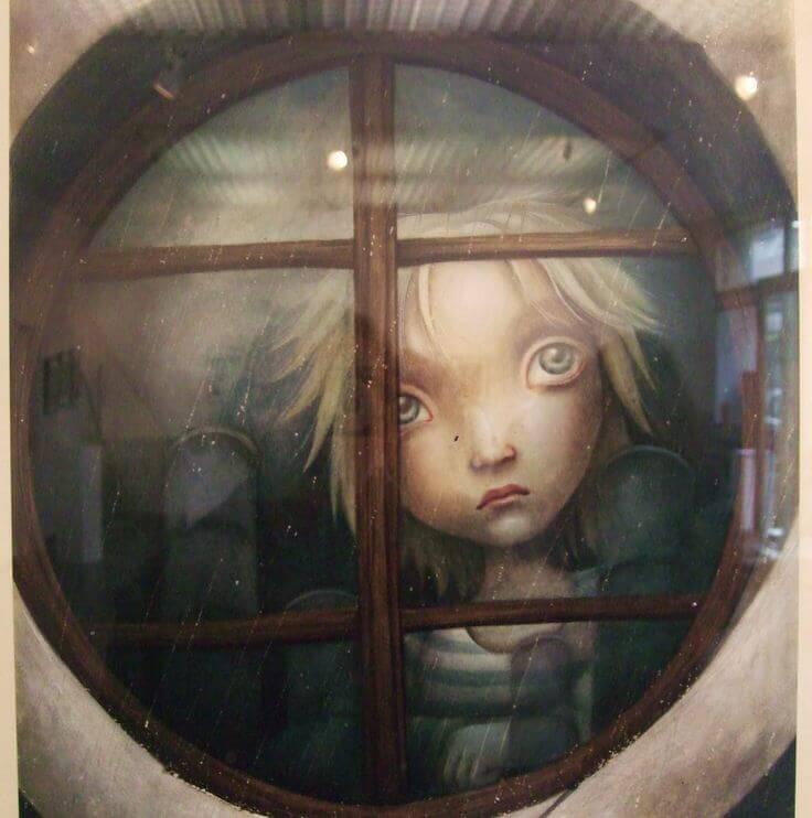 Niño-triste-tras-la-ventana