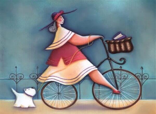 femme sur son velo avec son chien