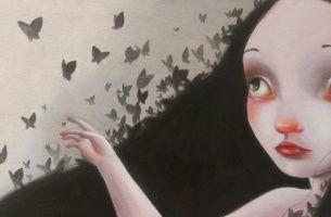 fille triste papillons