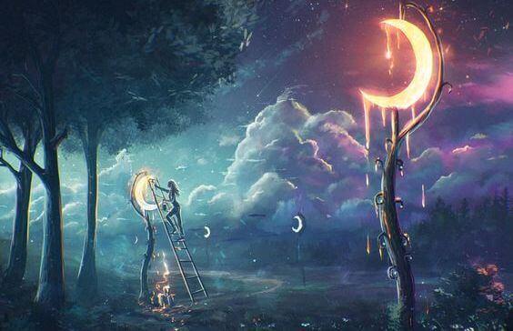femme en train d'accrocher des lunes dans les arbres