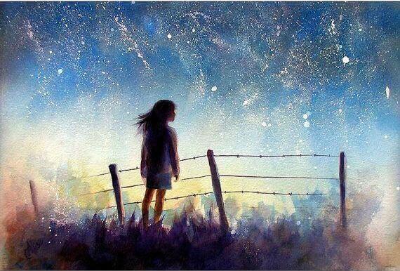 joven-envuelta-en-un-cielo-estrellado