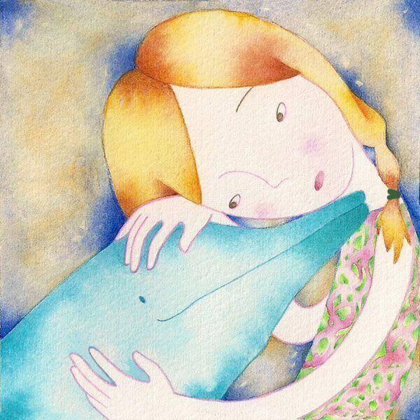 petite fille avec un dauphin