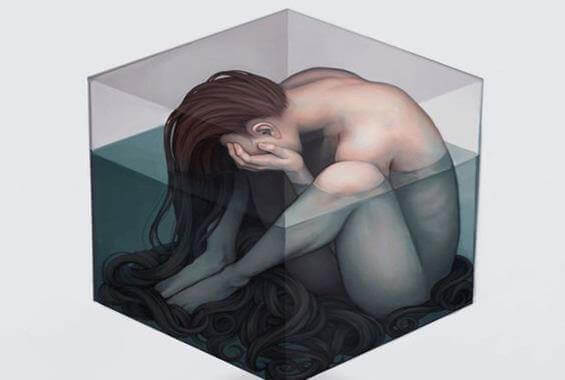 Femme-triste-dans-un-cube