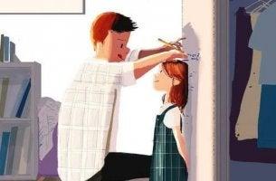 Homme-marquant-la-taille-d'une-fille-sur-une-porte