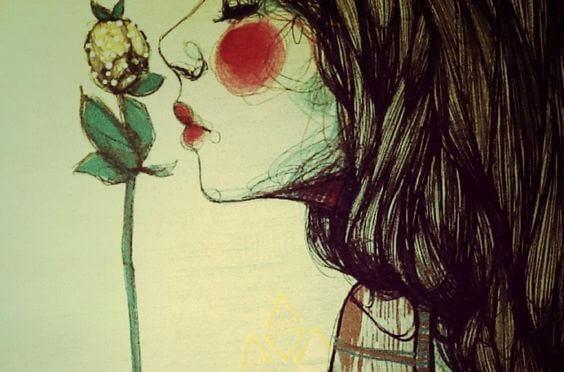 Femme-sentant-une-fleur