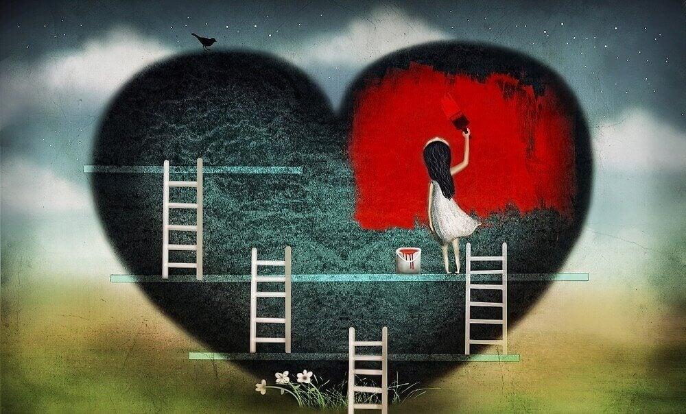 Fille-peignant-un-coeur-rouge