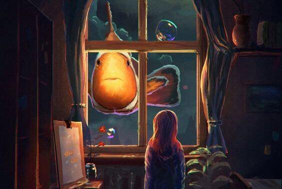 Fille-regardant-une-poisson-methode-Montessori
