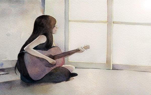 Femme-et-guitare-sur-le-sol
