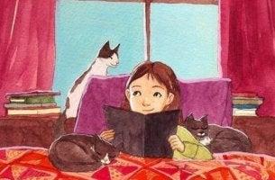 nin%cc%83a-leyendo-un-libro-rodeada-de-gatos