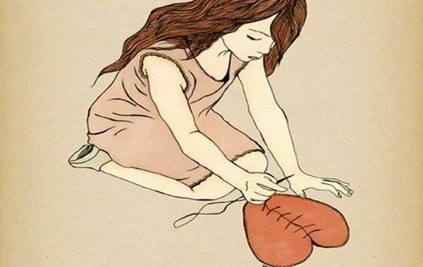 femme-cousant-un-coeur