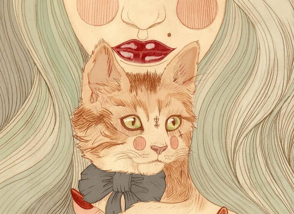 chat devant un visage de femme