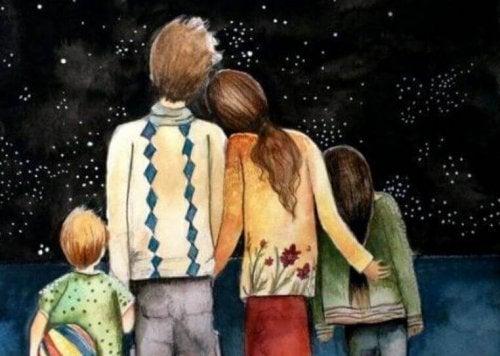 famille tissant des liens familiaux devant les étoiles