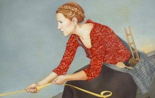 femme qui tire sur une corde