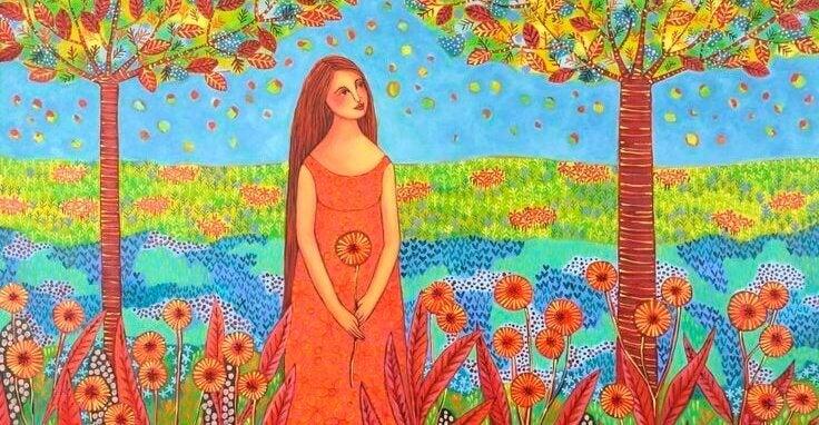 fille dans un champ de fleur