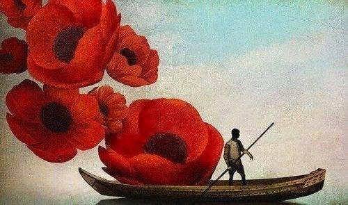 homme sur une barque avec des coquelicots