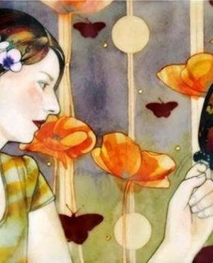 Femme avec papillon dans la main