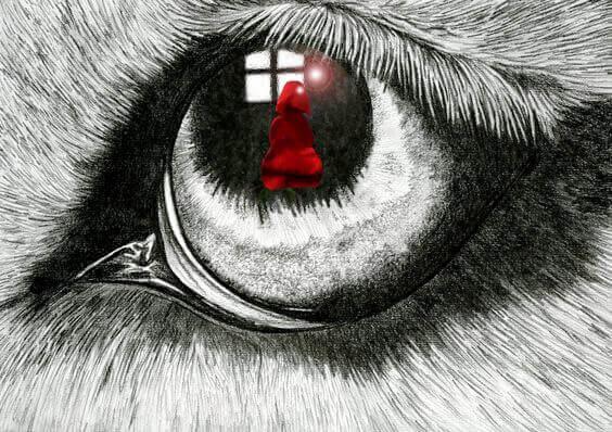reflet du petit chaperon rouge dans l'oeil du loup