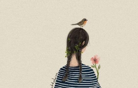 fille avec un oiseau sur la tête