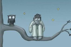 homme insomniaque sur une branche