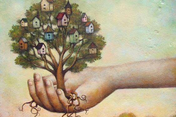 arbre fourni de maison dans la main de quelqu'un