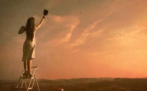 femme qui peint le ciel