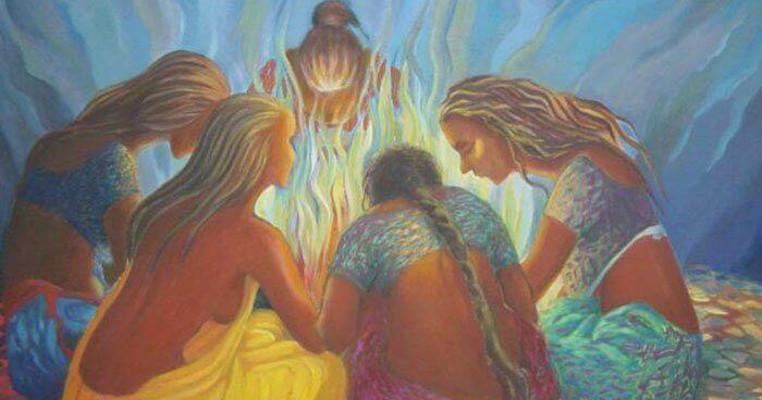 femmes réunies autour d'un feu