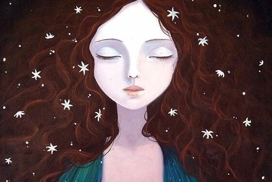 femme avec des étoiles dans les cheveux