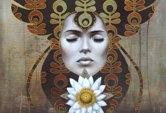 Femme avec une fleur blanche