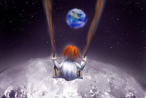 enfant faisant de la balançoire dans l'espace