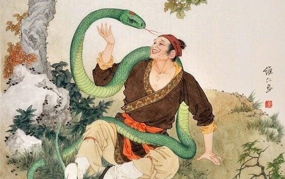 homme avec un serpent