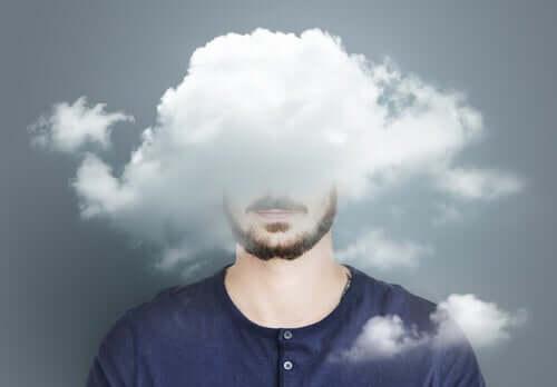 Le désespoir représenté par des nuages sur la tête d'un homme