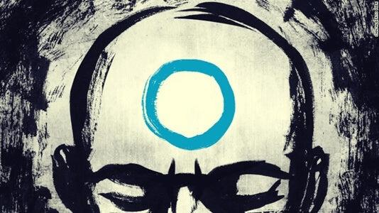 Un homme avec un cercle bleu sur le front