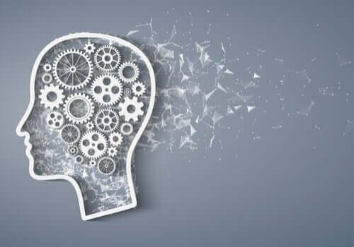 Le quotient intellectuel représenté par des engrenages dans le cerveau