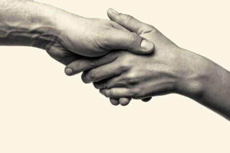 Une illustration représentant une poignée de main.